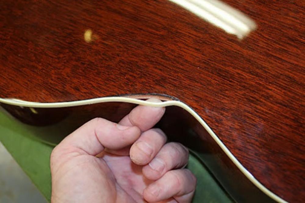 Parti scollate sulla chitarra acustica